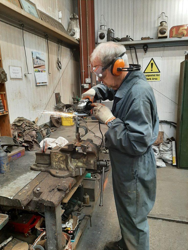 John Dixon fabricating a new vacuum pipe support bracket