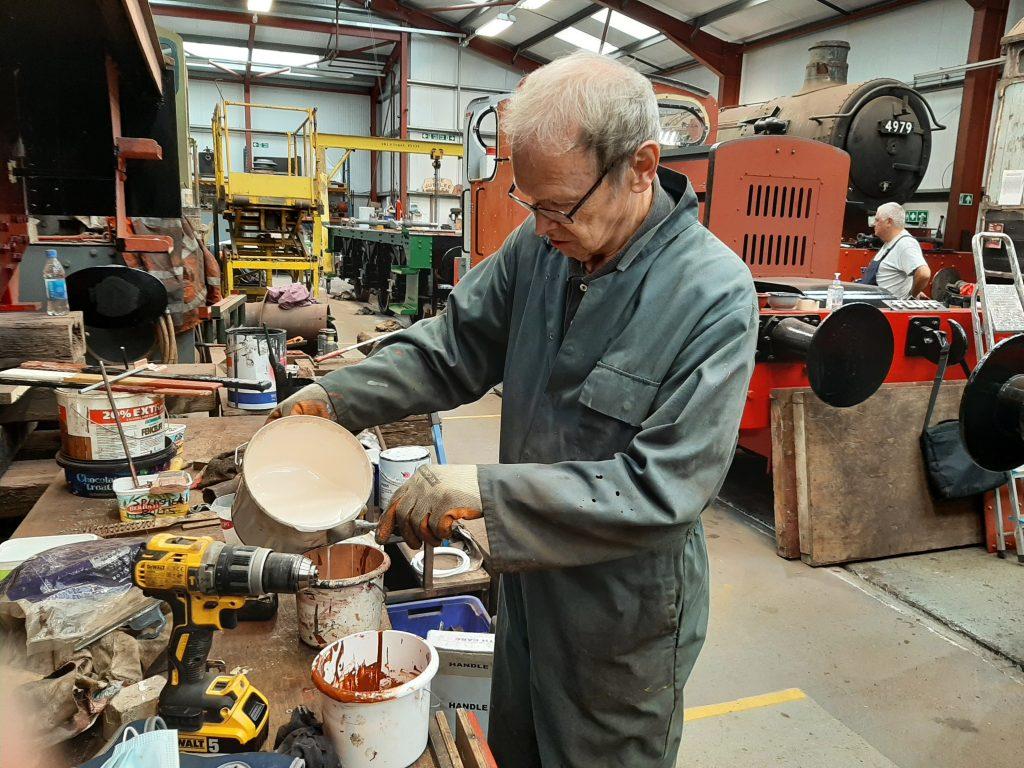 John Dixon preparing the 2 pack paint