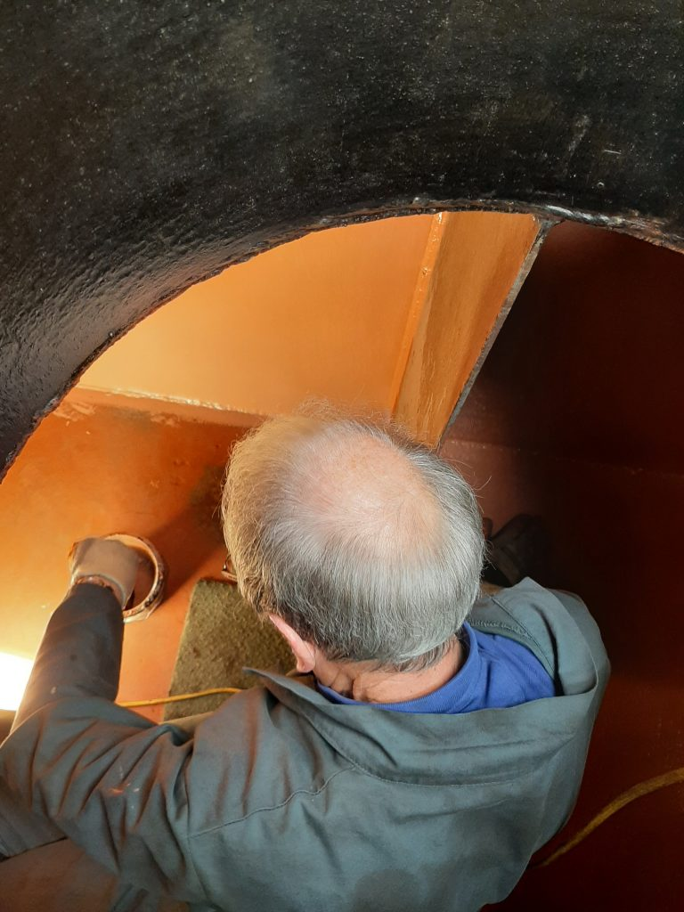 John Dixon busy in the tender tank