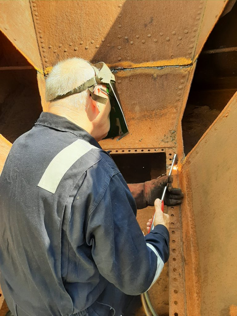 Ron Crowe cutting more steel from Wootton Hall's tender tank