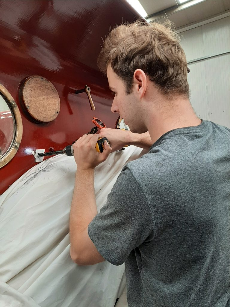Sam drills a new hole in FR 20's cab spectacle plate