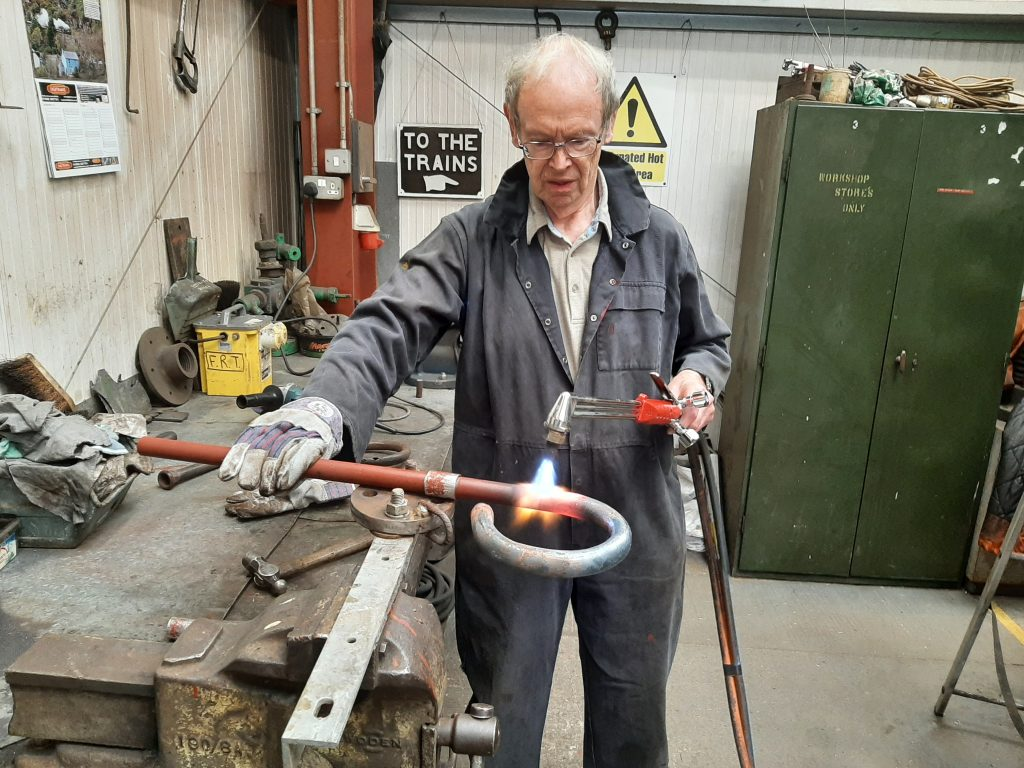 John Dixon fabricating a new blower ring for FR 20