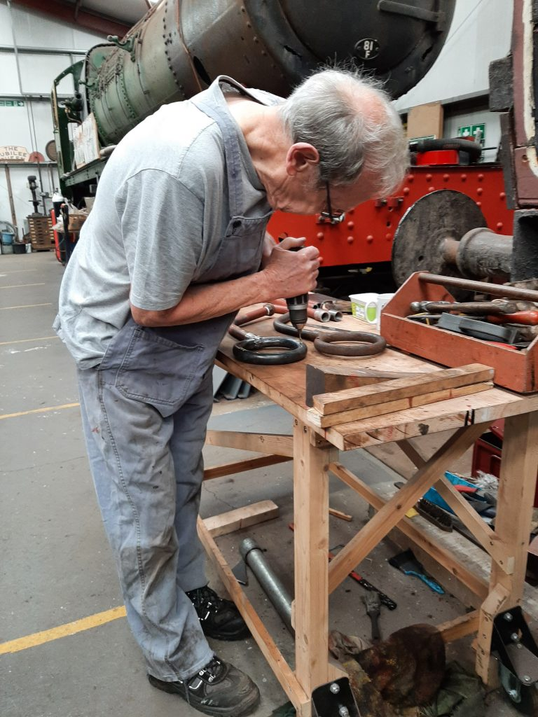 John Dixon drills new holes in the upper side of the new blower ring for FR 20