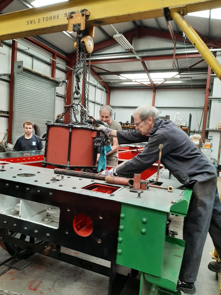 Lowering Wootton Hall's tender vacuum cylinder into the tender frames