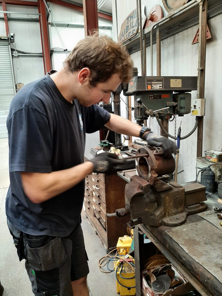 Sam opening out holes in one part of FR 20's steam pipe