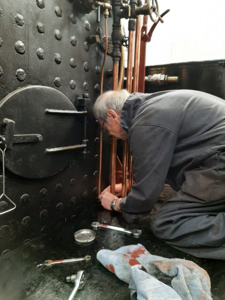 John Dixon fits retaining clamps for the water gauge drain pipes