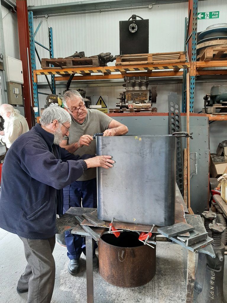 Alan and Keith putting together new steelwork for the new water take off box for Wootton Hall's tender