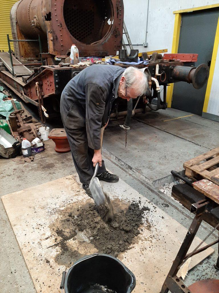 John Dixon mixes concrete for FR 20's smokebox floor