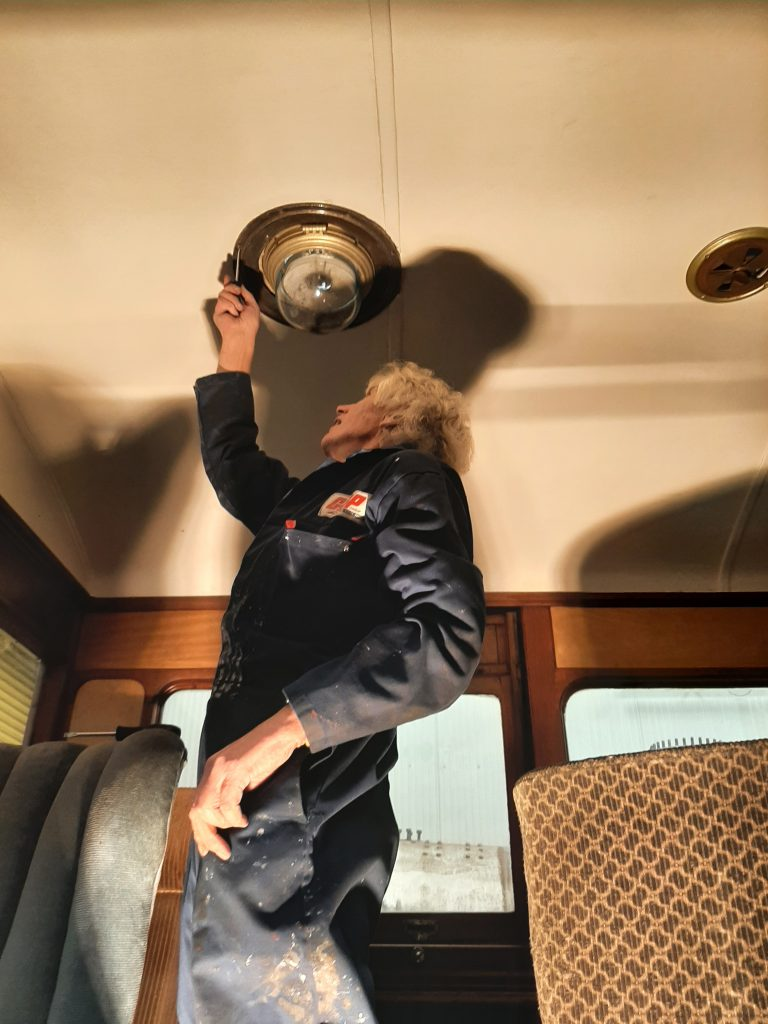 Ed removes one of the interior light fittings from GER No. 5
