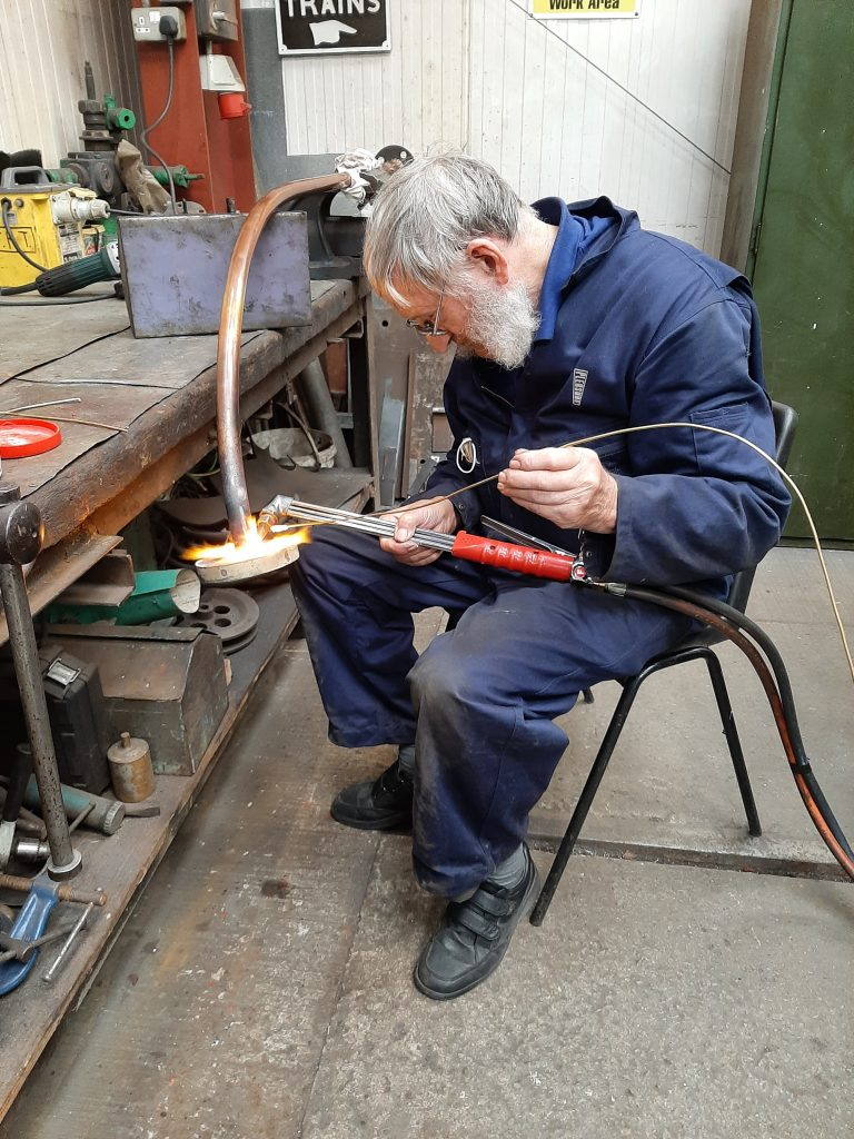 Alan repairing a joint on FR 20's right hand injector steam pipe