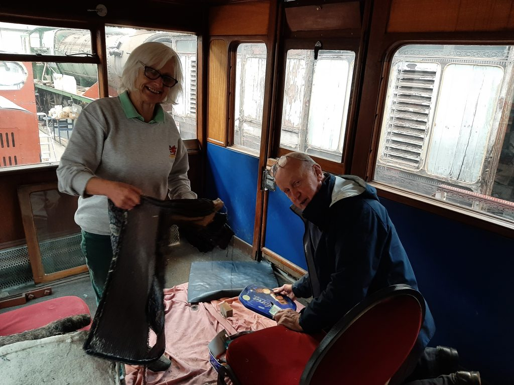 Anne and Phil Bolton working on the upholstery in GER No. 5