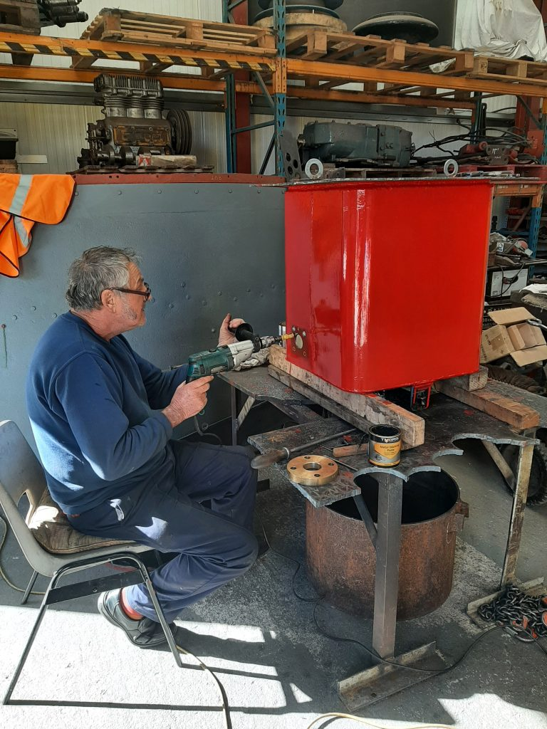 Keith drilling holes in Wootton Hall's tender water take off tank