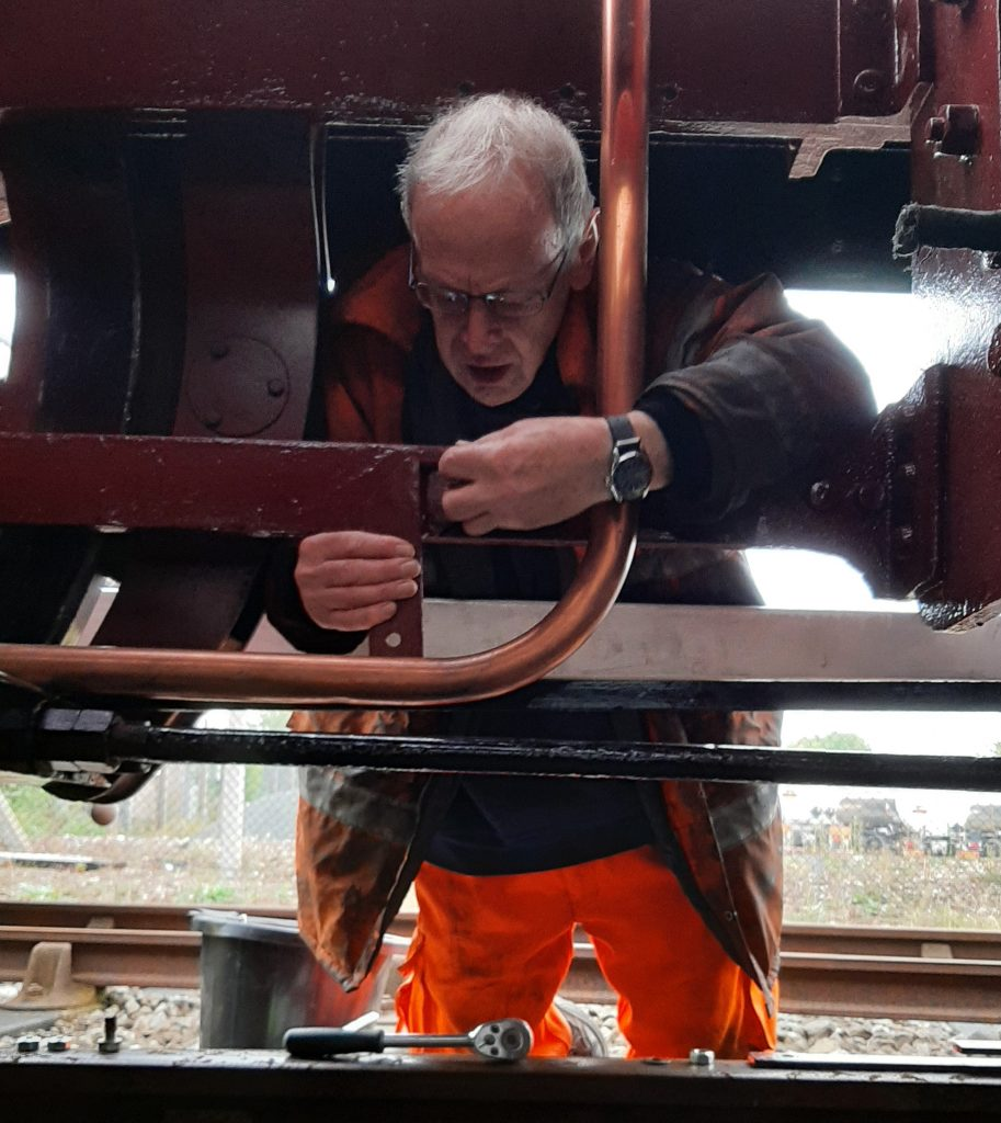 John Dixon fits a new pipe retention bracket on FR 20's frames