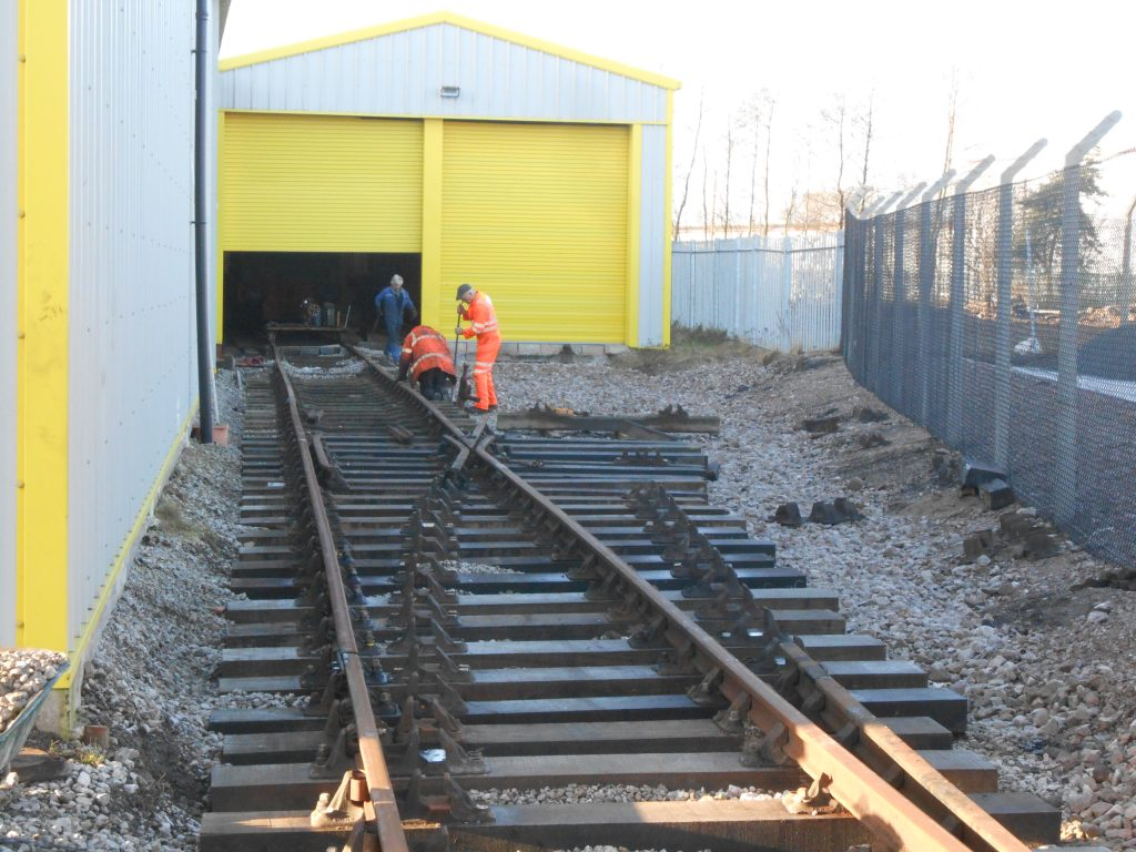 The trackworks progressing outside the shed