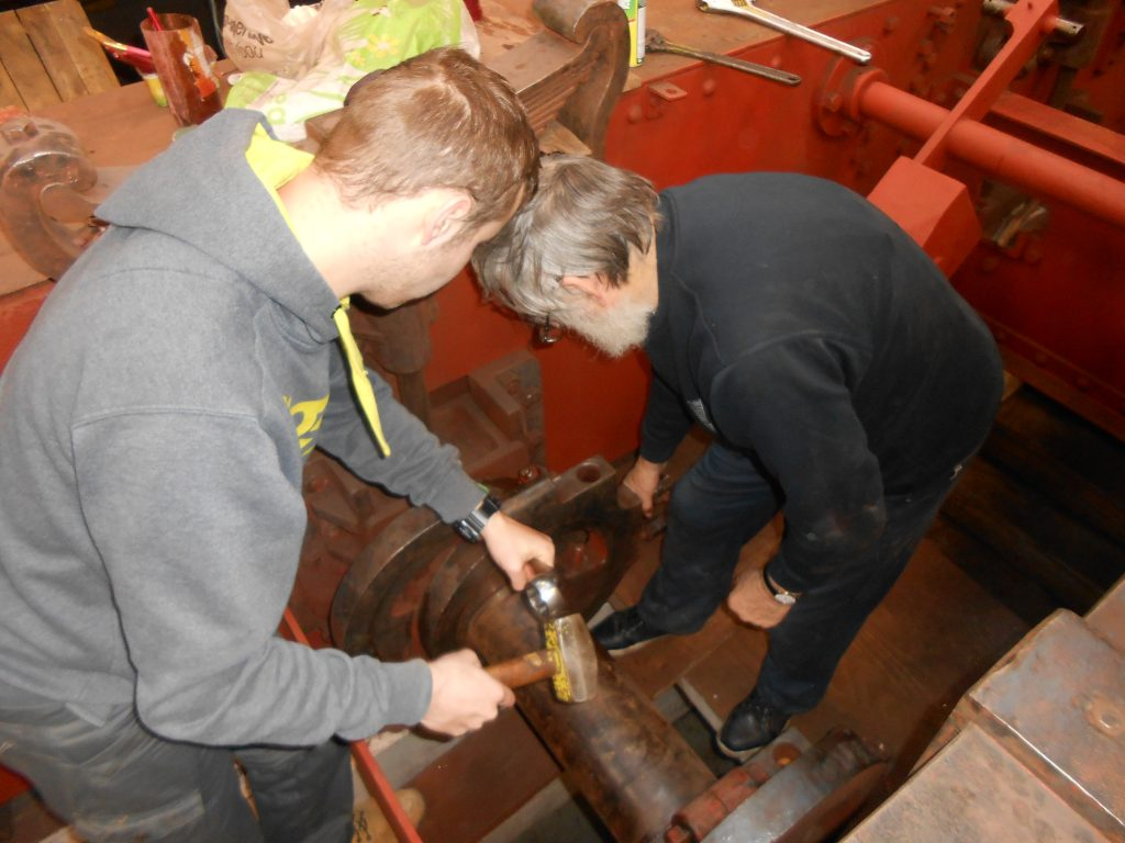 Alan and Sam working to remove an eccentric strap on Caliban
