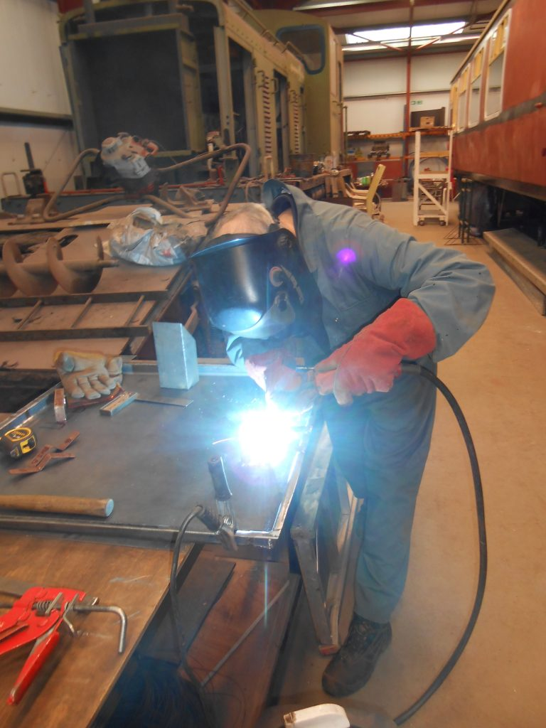 John welding the gas box handles