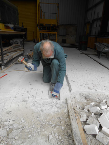 ... while John sets to, to provide an edge for the new apron concrete to key onto