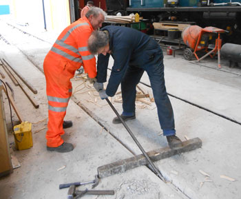 Keith Ray and Mike Rigg trying to extract the shuttering from the concrete