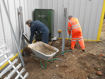 Concreting in the base of the new fence around the heating equipment
