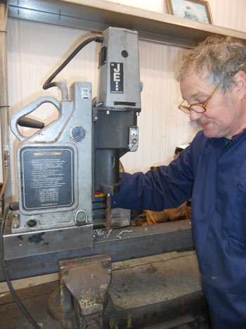 Keith drills a new piece of angle for the front tender drag box