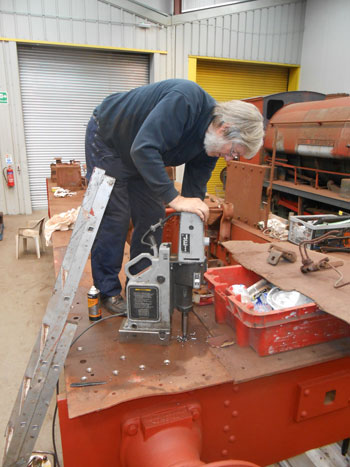 Alan drilling out more rivets on Caliban