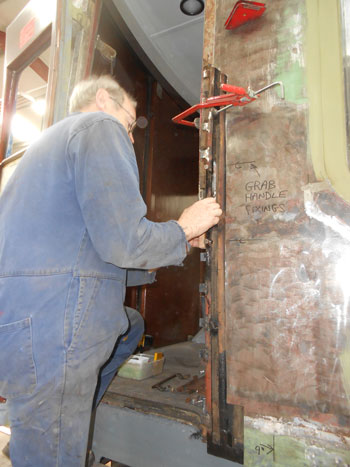 John getes back to door fixing