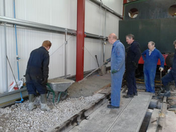 Creating the final pathway on the western end of the shed
