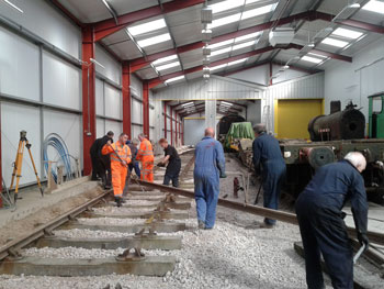 The gang assembles to move the second of the two rails on Wednesday